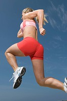 Woman jogging low angle