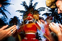 Masked devil dancers at carnival, blurred motion