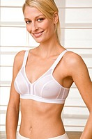 Blond woman in a sports bra in front of a Japanese wall
