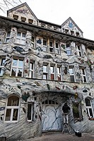 Graffiti house facade with beetles, painter at work, old houses of former squatters, Kiefernstrasse, Flingern, Duesseldorf, North Rhine-Westphalia, Ge...
