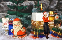 christmas decoration with candle, presents and a woman with christmas cap