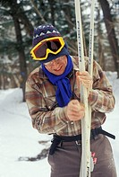 Porcupine Mountains State Park, Michigan - Fred Wood waxes his skis while on a winter camping trip in the Porcupine Mountains