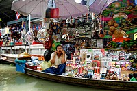 Vendor on the phone, Damnoen Saduak Floating Market, river market, Bangkok, Thailand, Asia