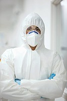 Scientist in protective clothing with arms crossed (thumbnail)