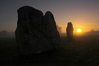 Avebury at sunrise on a misty morning, Avebury is the largest stone circle in the world, it is 427m in diameter covers an area of 28 acres and is situ...