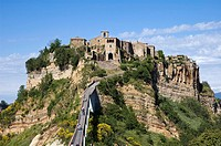 Civita di Bagnoregio Tuscany  It was founded by Etruscans The town is noted for its striking position atop a plateau of friable volcanic tuff overlook...