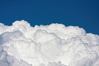 White cumulus clouds against blue sky
