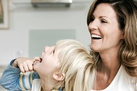 Blonde son and mother laughing