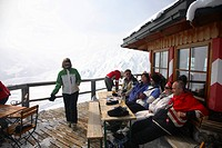 Tourists on Wintersport, restaurant on top of the mountains of Austrian Alps, Tyrol, Tirol, Austria