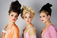 three models with extravagant hairstyle
