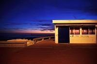A building near the sea is illuminated by the light of a candle street during sunset. Aguda, Vila Nova de Gaia, Portugal