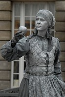 Street artist painted in silver as market woman with apple in her hand, beside the Hamburger Rathaus, Hamburg City Hall, Hamburg, Germany, Europe