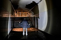 Eery scene of a man in a tunnel at the Warschauer Bruecke in Berlin, Germany, Europe