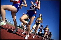 Group of female runners racing on a track