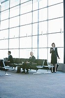 Business executives waiting at the airport lounge
