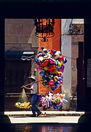 Balloon seller in front of a building entrance, Queretaro, Mexico, North America