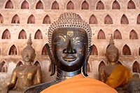 Head of a bronze Buddha statue and clay Buddha statues, Wat Sisaket, Vientiane, Laos, South East Asia