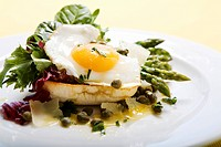 Fried egg and green asparagus on toast