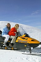 two women on snowmobile