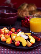 Christmas breakfast with fruit salad and orange juice