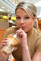 young woman having ice coffee