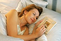 woman lying in bed and thinking of her sweetheart