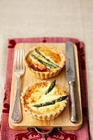 Two asparagus and parmesan tarts