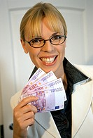 woman holding money bills in hand