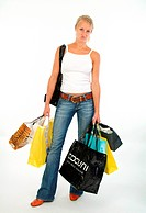 young blond woman with numerous shopping bags
