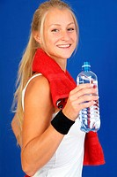 slim blond woman in sport dress with water bottle and red towel