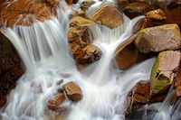 Etive river cascades, water flowing over red rocks, United Kingdom, Scotland, Highlands, Glen Etive
