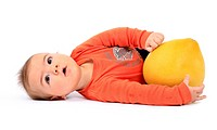 baby lying on lateral position with pomelo