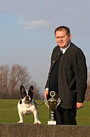 French Bulldog Canis lupus f. familiaris, man with male dog and cup