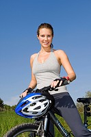 young pretty woman on a mountainbike
