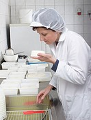 Peasant woman verifying cream cheese, Austria