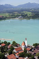 church at Forggensee, in the background theatre, Germany, Bavaria, Allgaeu, Waltenhofen