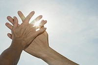 Couple´s hands blocking the Sun