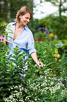 woman in blue shirt gardening