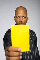Soccer referee presenting yellow card