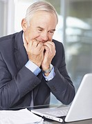 Worried senior businessman with a laptop