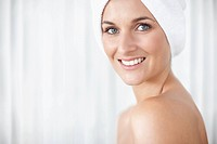 Pretty lady with towel wrapped on head