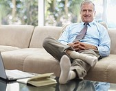 Senior businessman relaxing on couch