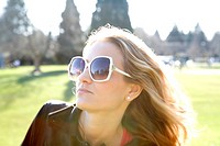 Woman in glamorous sunglasses in park