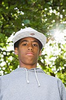 Black Teenager in a park with lens flare