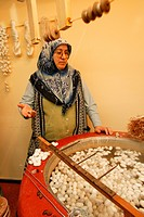 Woman unravelling silkworms, carpet production, southern Turkey, Asia