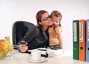 businesswoman with child in office