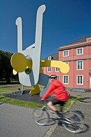 cyclist in frjnt of the work of art near the Ludwig_gallery at castle Oberhausen at the Kaisergarten, Germany, North Rhine_Westphalia, Ruhr Area, Ober...