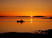 St Marys Bay HOLM ORKNEY Sunset over Scapa Flow fishing creel boat