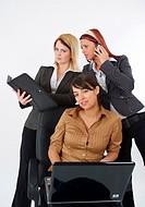 three young and busy businesswomen