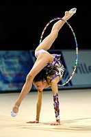woman doing rhythmic gymnastics with hoop